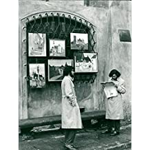 Vintage photo of The freeer atmosphere in Poland after Gomulka has also influenced the art. Here are two young artists exhibiting on a street in Warsaw's old town