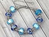 Bracelet Charms pour femme Thurcolas modèle Manhattan en acier inoxydable avec perles bleues en verre