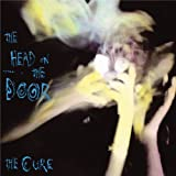 Songtexte von The Cure - The Head on the Door