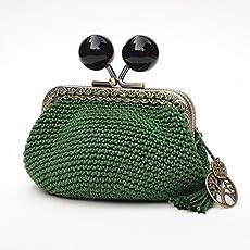 Monedero de estilo vintage de mujer con boquilla tejido en ganchillo verde.