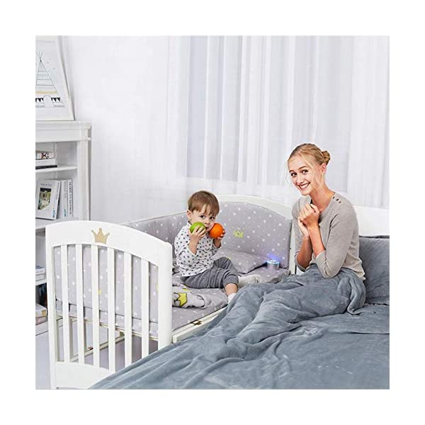 Solid Wooden Baby Cot,toddler Bed, Multifunctional White Cradle Bed Newborn Stitching, Height Adjustable HXYL Package contains bed, mosquito net, mosquito net pole, moving caster, kit Split panel for connecting to a large bed Three heights are adjustable to suit your child's different needs 3