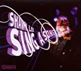 Songtexte von Shawn Lee - Sing A Song