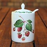 Moderne Marmeladendose und Löffel, Raspberry