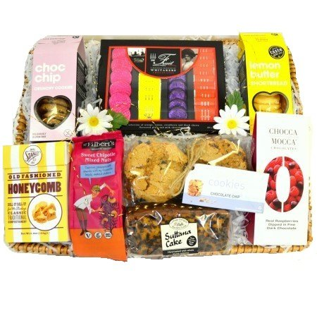 A Sharing Hamper. A Willow Basket brimming with sweets, cookies and cakes - made for sharing. Baskets By Wickers.