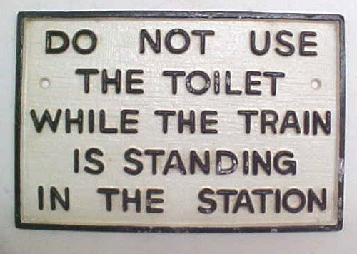 do-not-use-toilet-while-the-train-is-standing-in-the-station-large-cast-iron-sign-by-nordstrom