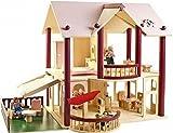 Puppenhaus mit einer Terrasse und Holzpuppen