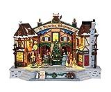 Lemax Piazza In Festa Per Celebrare Il Natale, Illuminata, Sottofondo Musicale, Alcunin Personaggi Si Muovono E Altri Cantano. A