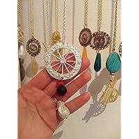 regalo di natale collana ruota carretto siciliano ottone argento barocca pietra lavica dell'etna nera corallo rosso perla di fiume scaramazza pietre dure