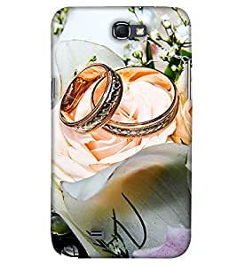 PrintHaat Designer Back Case Cover for Samsung Galaxy Note 2 :: Samsung Galaxy Note Ii N7100 (lovely wedding rings of a couple :: romantic moments :: beautiful rings with white roses :: celebrate life :: in gold white and green)