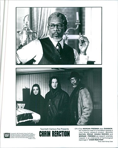 "Vintage photo of (Top) Morgan Freeman plays Shannon, the mysterious head of a foundation backing a risky energy research project; (bottom) Rachel Wiesz, Keanu Reeves and Morgan Freeman are research scientists trapped in an underworld of technological espionage in ""Chain Reaction."" 1996."