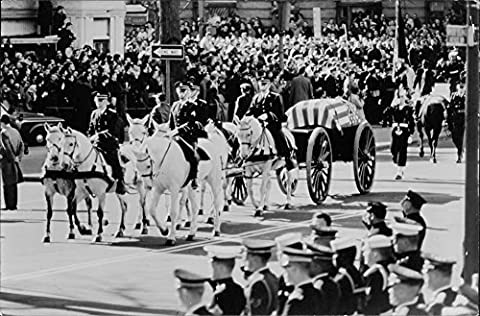 Vintage photo of A horse drawn carriage carrying the coffin of US. President John F. Kennedy assassinated Nov