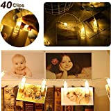from Exqline LED Photo Clip String Lights - Exqline 40 Photo Peg Lights 5M Battery Powered Fairy Lights Perfect for Hanging Photos, Notes, Paintings Card and Memos Indoor Outdoor Decoration - Warm White