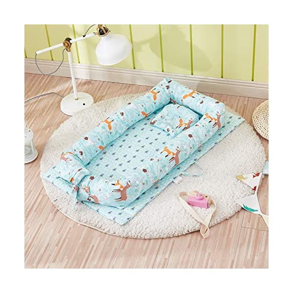 TEALP Multifunctional Baby Nest Blue Bear Fox, Baby Bassinet for Bed/Lounger/Nest/Pod/Cot Bed/Sleeping, Breathable & Hypoallergenic Cotton (0-24 Months) TEALP 【Breathable and Hypoallergenic Cotton】hypoallergenic materials, breathable and non-toxic. We use 100-percent cotton fabric and breathable, hypoallergenic internal filler, which is safe for baby's sensitive skin. It will give your child serene, safe, and sound sleep in their lovely co sleeping crib. 【Adjustable Design】1 baby nest, 90x55x15cm;1 pillow30x30cm, Suitable for 0-24 Month. GROWS WITH YOUR BABY. Being adjustable, the side sleeper grows with your baby. Simply loosen the cord at the end of the bumpers to make the size larger. The ends of the bumpers can be fully opened. 【Multifunctional and Portable】 Use the infant nest as a bassinet for a bed, baby lounger pillow, travel bed, newborn pillow, changing station or move it around the house for lounging or tummy time, making baby feel more secure and cozy. 2