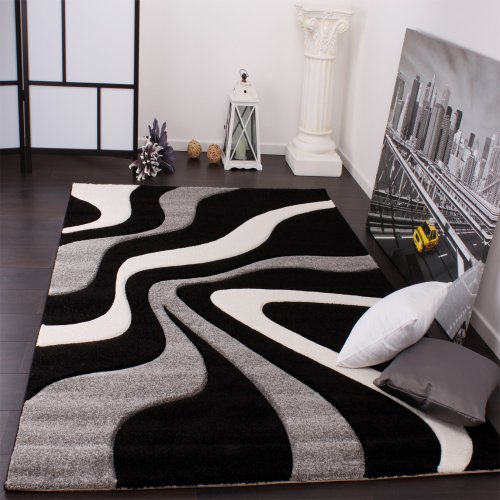 to living rugs black make room is classical associated glamorous statement how with combination decors white often striped a carpet and the for rug