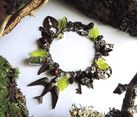 Bracelet automnal : arbre de vie, oiseau,clés,pommes de pins,coeur ,cadenas, clé, fiole, mousse,perles bois,perles jaunes ,fleur lucite