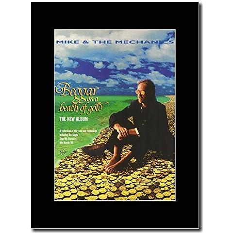 Mike y la mecánica - mendingo en una playa de Promo en una revista de oro de color negro