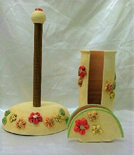 Tris 3 pezzi in ceramica linea fiori rossi a rilievo.