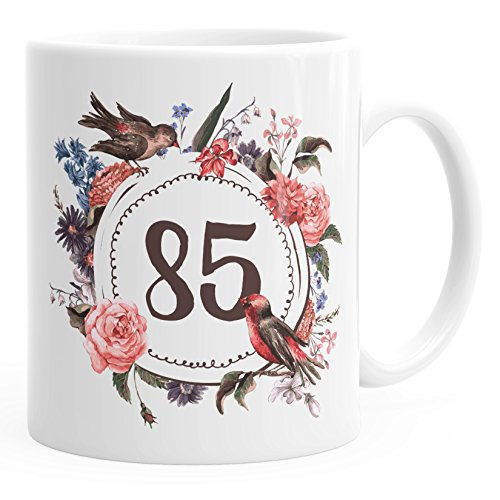 MoonWorks Geburtstags-Tasse 85 Fünfundachzig Geschenk-Tasse Kaffee-Tasse Blumen Blüten Blumenkranz Weiß Unisize 85