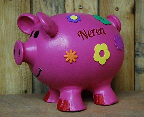 Cerdita rosa hucha con flores. Disfrazada y personalizada. mide 23 cm de ancho x 18 cm de ancho