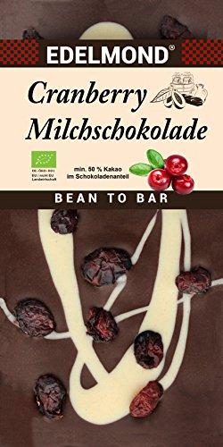 Edelmond Cranberry Milchschokolade Bio Cranberrys darin und darauf. Dekoriert mit weißer Schokolade. Eine ganz besondere Geschenk-Idee aus Fair-Trade Kakao.
