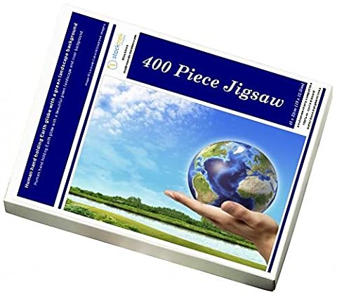 Photo Jigsaw Puzzle of Human hand holding Earth globe with a green landscape background