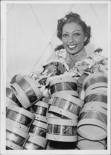 josephine-baker-standing-behind-several-small-drum-set