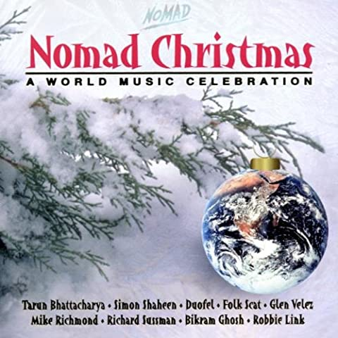 Nomad Christmas-World Music Ce [Import allemand]