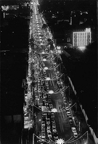 vintage-photo-of-bird-eye-view-of-a-busy-road-with-festive-lights-decorating-along-the-way
