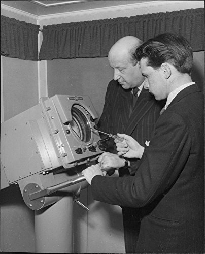 vintage-photo-of-from-left-rosenstram-engineer-and-technologist-romell-testing-the-new-us-telektron-
