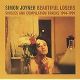 Beautiful losers : Singles & Compilation Tracks (1994-1999)