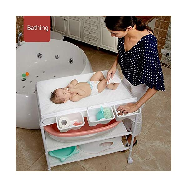 White Newborn Changing Table On Wheels, Baby Bathing Massage Baby Cot Foldable Changing Diapers Dresser with Pad GUYUE Two in one design- Baby changing table can be used as baby massaging table as well or dry your baby's small clothes, also can bathing. Iron tube paint + high quality plastic + polyester 3D mesh. Smooth mute caster. 3