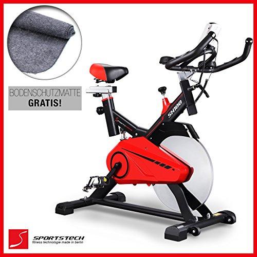 Sportstech Profi Indoor Cycle SX100 mit 14KG Schwungrad, gepolsterter Armauflage, Komfortsattel mit Sitzfederung, Pulsmessung - Speedbike mit flüsterleisem Riemenantrieb - Bodenschutzmatte gratis