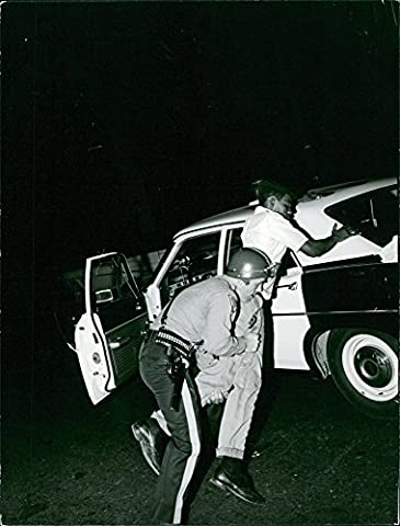 Vintage photo of Policeman arresting a man in Newark, New Jersey.Taken - Circa 1967