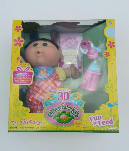 30th-celebration-cabbage-patch-kids-fun-to-feed-baby-girl-with-brown-pigtails