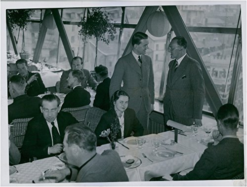 vintage-photo-of-ake-adler-and-latvian-architect-n-voits-standing-and-talking-at-the-welcome-lunch-o