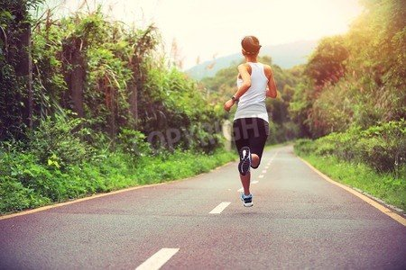 "Poster-Bild 120 x 80 cm: ""Runner athlete running on forest trail. woman fitness jogging workout wellness concept."", Bild auf Poster"