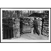 POSTER Loading up a truck with the finished work In timber yard at edge of wood, three men in civilian clothes are shown loading onto wooden crate. The crate appears Scotland Wall Art Print A3 replica - Work Truck