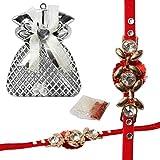 Designer Rakhi Studded with Crystal Diamonds on Golden Pattern comes with Elegant Case