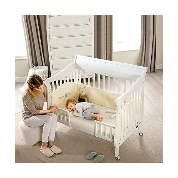 DUWEN-Cot bed Solid Wood Multifunction Baby Cot European Style Cot Bed Toddler Bed Splicing Bed With Wheel (color : White) DUWEN-Cot bed 1. This multifunctional crib is made of environmentally-friendly pine wood. It is tough and durable, not easy to crack. It has a load-bearing capacity of more than 120KG. It is green and non-toxic paint. It is healthy and environmentally friendly. It is harmless to the baby. Mother can buy with confidence. 2. The three pedestal positions of the crib are suitable for the baby's growth stage, improving visibility and ventilation in all directions, selecting the gear according to the baby's body and age, making the space bigger and more comfortable to use. 3. Multi-functional crib can be easily converted into a game bed, children's sofa, designed for healthy sleep of 0-6 years old baby (additional function can be used up to 6 years old), 55mm safety standard guardrail spacing, children's hands and feet will not be stuck 4