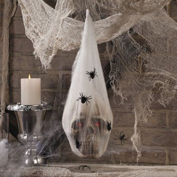 (LED Skull in Spider Cocoon - Halloween Party Supplies & Decorations & Home Decor by Oriental Trading Company)