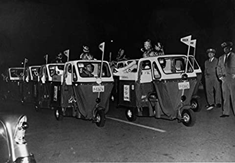 """POSTER Mailsters parade c 1954 Object number A 2009 56 Medium paper photo emulsion Unframed 8 10 To promote their newest mail carrier vehicles postal officials organized a group mailsters an appearance a holiday parade mailsters bore banners Santa's reindeer """"Rudolph"""" vehicle lead That mailster has been fitted w"""