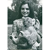 Vintage photo of A young lady named Annie Bonnet carrying a tiger cub.Taken - Circa 1971