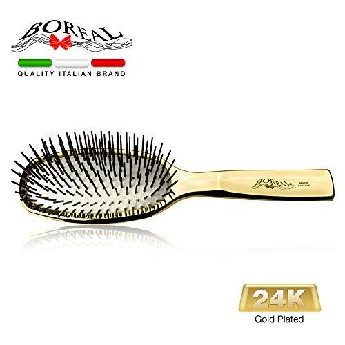 Brosse cheveux de luxe. 24 carats d'or, avec pointes en plastique arrondis. Emballé dans un étui transparent. Parfait comme idée cadeau. Produit 100% italienne.