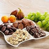 Schokofrüchte Viererlei (400g) Genießen Sie Früchte einmal anders: Datteln, Feigen, Aprikosen und Rosinen überzogen und verziert mit feinster weißer, Zartbitter- und Vollmilch-Schokolade