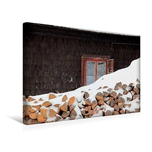 Preisvergleich Produktbild Premium Textil-Leinwand 45 cm x 30 cm quer, Brennholz vor Haus im verschneiten Böhmerwald, Tschechische Republik, Europa | Wandbild, Bild auf ... Tschechische Republik (CALVENDO Orte)