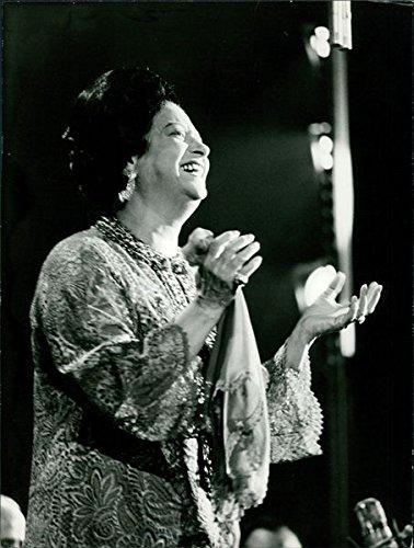 Reprint of Umm Kulthum smiling.