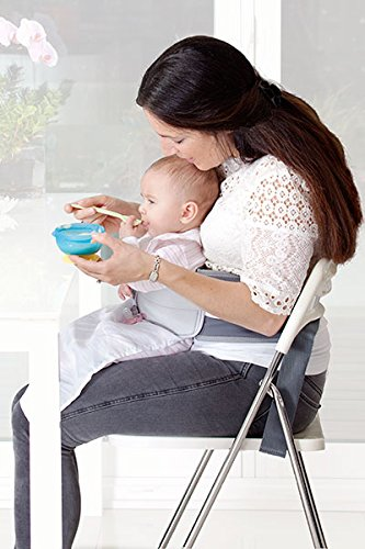LapBaby: Hands-free babywearing highchair, baby harness and weaning aid. LapBaby Designed in the UK, LapBaby is a hands-free belt that comfortably secures a baby in an adults' lap leaving both hands free to eat, work, read/wean/play with baby or engage with another child. Suitable for use from 3 months old  (before high chair age), LapBaby is soft and gentle on your baby's sensitive skin, made from materials that are free from harmful chemicals and allergens. LapBaby is light and portable so not only a baby essential at home, it's perfect for travel especially cafes, aeroplanes and trains 9