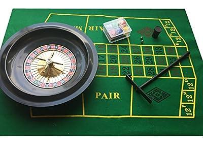 Jeu de roulette avec jetons, tapis et râteau