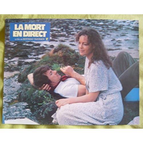 Série publicitaire de 15 photos couleurs (21 cm x 27 cm) de La mort en direct (1980), film réalisé par Bertrand Tavernier avec Romy Schneider, Harvey Keitel, Harry Dean Stanton, etc. - Bon état.