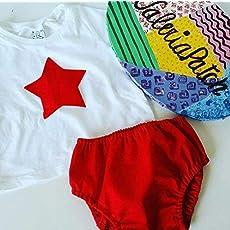 Cubrepañal tela rojo basic y posibilidad de añadir camiseta a juego estrella.